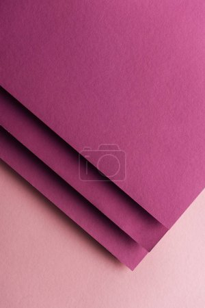 Photo for Top view of blank and colorful burgundy sheets of paper on pink background with copy space - Royalty Free Image