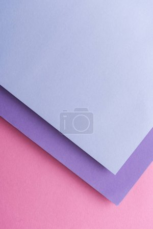 Photo for Top view of blue and purple sheets of paper on pink background with copy space - Royalty Free Image