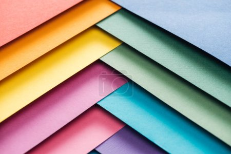 Photo for Blue, orange, green, burgundy, yellow, pink and purple sheets of paper with copy space - Royalty Free Image