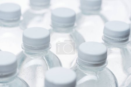 Photo for Selective focus of water bottles with caps on white background - Royalty Free Image