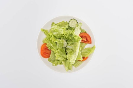 Photo for Top view of chopped salad on plate isolated on white - Royalty Free Image