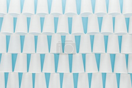Photo for Flat lay with white plastic cups isolated on blue with copy space - Royalty Free Image