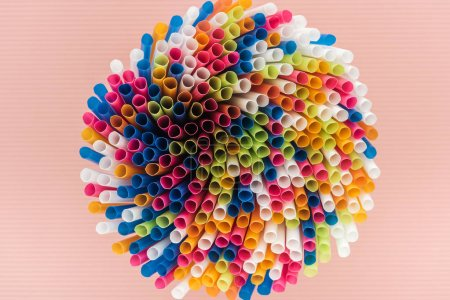 Photo for Top view of colorful and bright plastic straws isolated on pink - Royalty Free Image