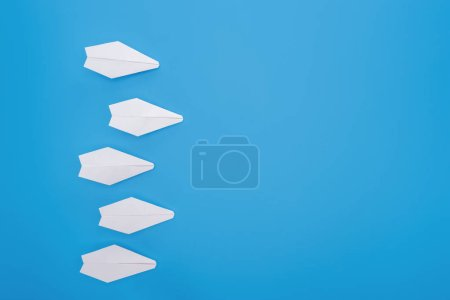 Photo for Flat lay with white paper planes on blue surface - Royalty Free Image