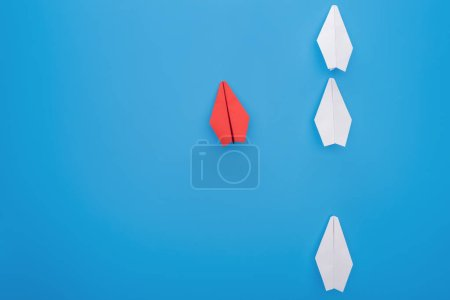 Photo for Flat lay with white and red paper planes on blue - Royalty Free Image