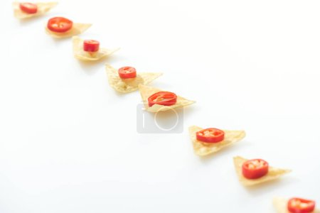 Photo for Flat lay with tasty nachos and sliced chili peppers on white background with copy space - Royalty Free Image