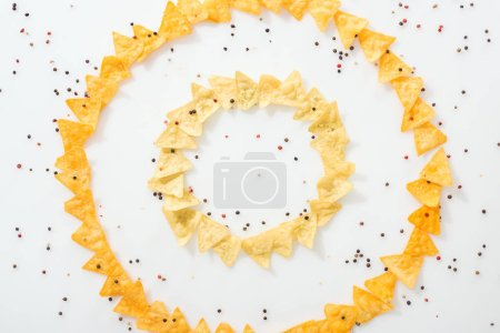 Photo for Flat lay with tasty nachos and spices on white background with copy space - Royalty Free Image