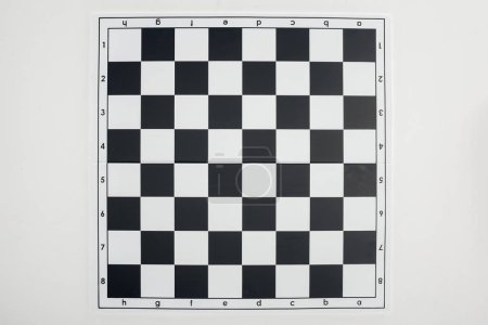 Photo for Top view of empty  black and white chessboard on white background - Royalty Free Image