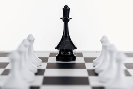 Photo for Selective focus of chessboard with black queen figure among white pawns isolated on white - Royalty Free Image