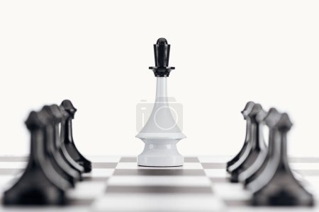 Photo for Selective focus of chessboard with white queen figure among black pawns isolated on white - Royalty Free Image