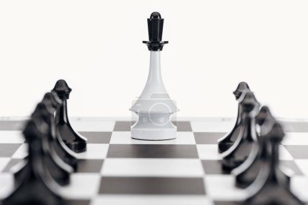 Photo for Selective focus of chessboard with white queen figure and black pawns isolated on white - Royalty Free Image
