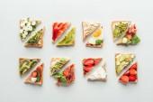 """Постер, картина, фотообои """"вид сверху вкусные тосты с фруктами и овощами, изолированные на белом фоне"""""""