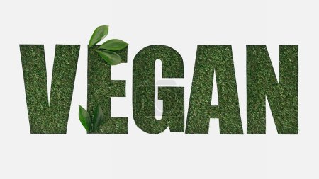 Photo for Top view of cut out vegan lettering on green grass background with leaves isolated on white - Royalty Free Image