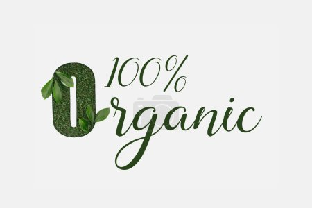 top view of green 100 % organic lettering with leaves isolated on white