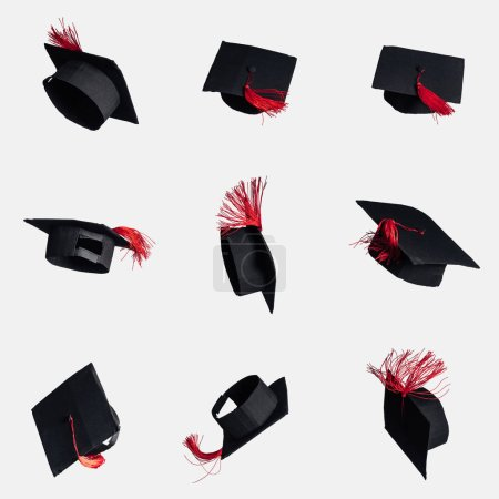 Black academic caps with red tassels isolated on white