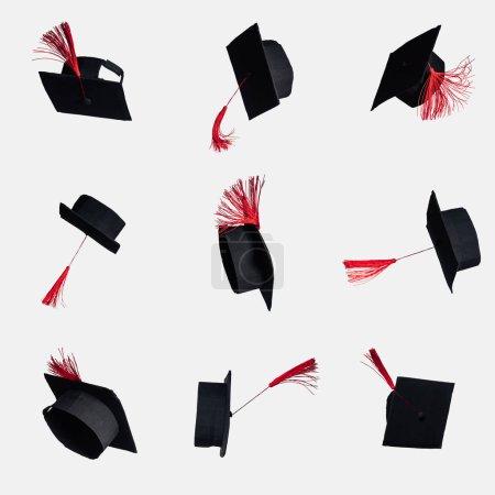 Photo pour Capuchons académiques noir avec des glands rouges isolés sur blanc - image libre de droit
