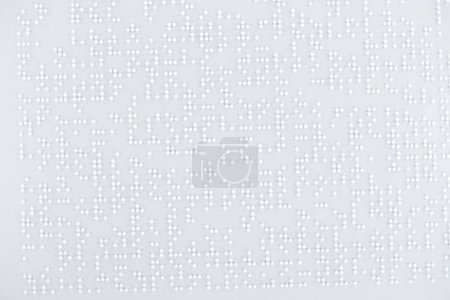 top view of text in international braille code on white paper