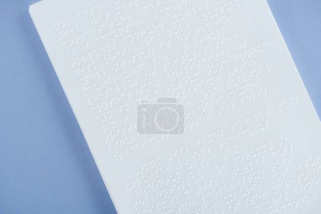 braille text on white paper isolated on violet with copy space