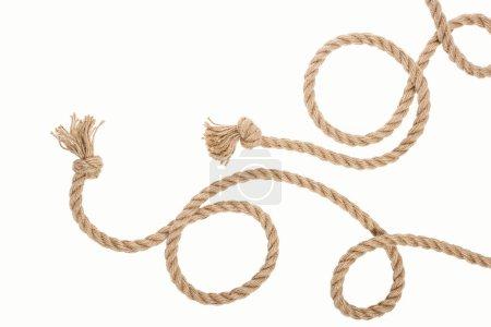 Photo pour Cordes de jute enroulée avec noeuds isolés sur blanc - image libre de droit
