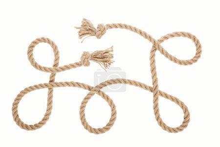 Foto de Cuerda larga marrón con nudos y rizos aislados en blanco - Imagen libre de derechos