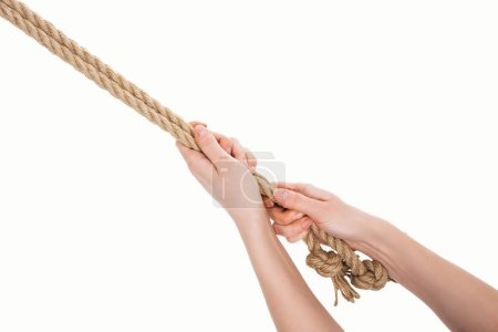 cropped view of woman holding jute ropes in hands isolated on white