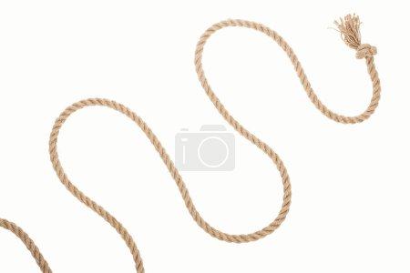 Photo pour Corde brune et ondulée avec noeud isolé sur blanc - image libre de droit