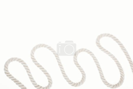 Photo for White waved and long rope isolated on white - Royalty Free Image