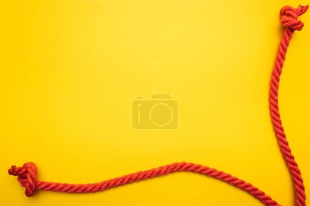 red jute ropes with knots isolated on orange