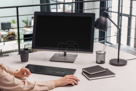 Photo for Cropped view of woman using computer at workplace in modern office - Royalty Free Image