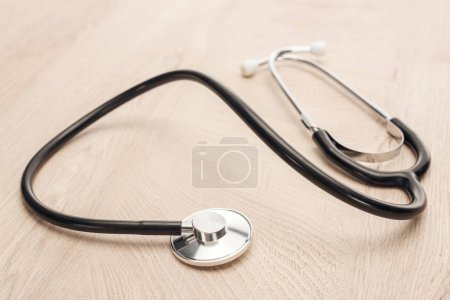 Photo for Selective focus of stethoscope on wooden and white table - Royalty Free Image