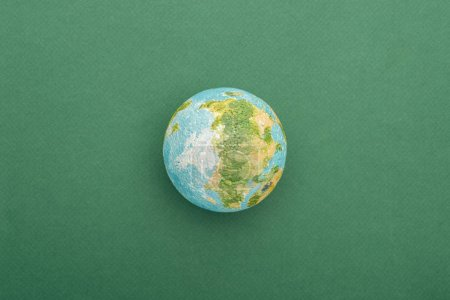 Photo for Top view of toy earth on colorful and green background with copy space - Royalty Free Image