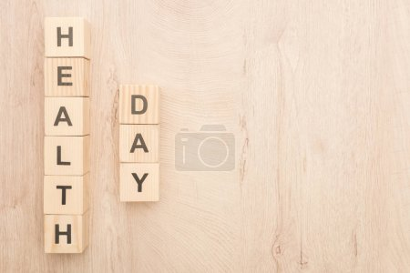 top view of cubes with health day lettering on wooden background with copy space