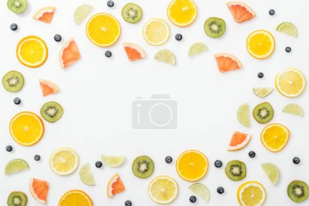 Photo for Flat lay with cut fruits and blueberries on white surface - Royalty Free Image