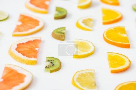 Photo for Juicy fresh sliced citrus fruits on white surface - Royalty Free Image
