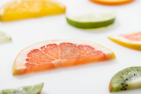 Photo for Juicy fresh sliced citrus fruits on white surface - Royalty Free Image