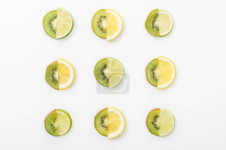 Photo for Flat lay with cut lemons, limes and kiwis on white surface - Royalty Free Image