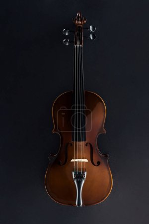 Photo for Top view of classical cello in darkness on black background - Royalty Free Image