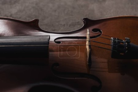 Photo for Close up of strings on classical wooden cello on grey textured background - Royalty Free Image