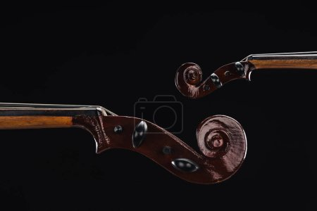 Photo for Close up of classic wooden cello with bow isolated on black - Royalty Free Image