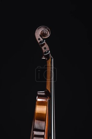 Photo for Close up of classic wooden cello isolated on black - Royalty Free Image