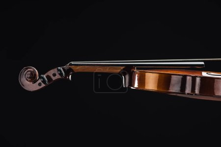 Photo for Close up of classic wooden violoncello isolated on black - Royalty Free Image