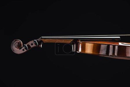 Foto de Close up of classic wooden violoncello isolated on black - Imagen libre de derechos