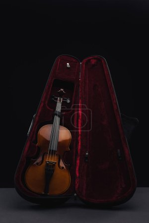 Photo for Classic wooden double bass in opened case isolated on black - Royalty Free Image