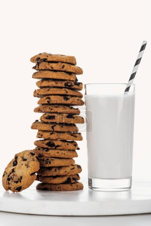 Photo for Delicious chocolate cookies near glass with straw and milk isolated on white - Royalty Free Image