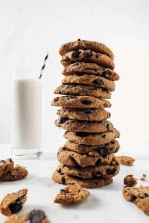 Photo for Selective focus of chocolate cookies near glass with milk and straw on marble table - Royalty Free Image