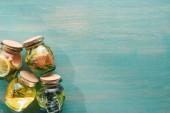 """Постер, картина, фотообои """"вид сверху на Детокс напитки в банках с фруктами, овощами, зеленью, ягодами и зеленью"""""""