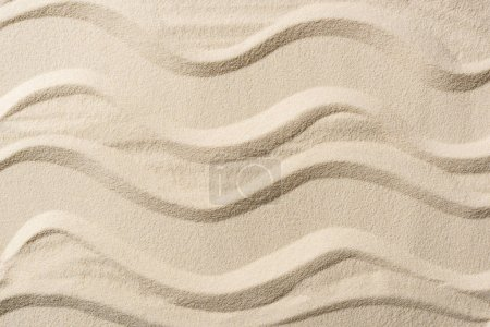 top view of textured background with sand and smooth lines