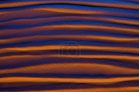 Photo for Top view of abstract textured background with sand, smooth waves and color filter - Royalty Free Image