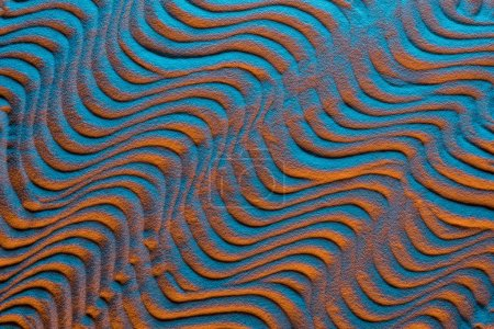Photo for Top view of sandy background with color filter and abstract waves - Royalty Free Image