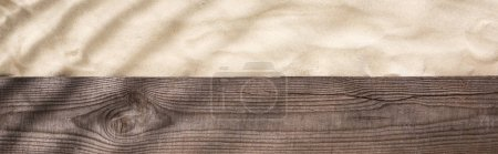 Photo for Panoramic shot of wooden brown board and sand with shadow and copy space - Royalty Free Image
